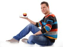 Man holding a book and one red apple full body Stock Photography