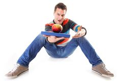 Man holding a book and one red apple full body Royalty Free Stock Photography