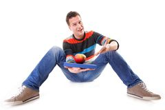 Man holding a book and one red apple full body Stock Image