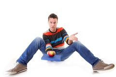 Man holding a book and one red apple full body Royalty Free Stock Photos