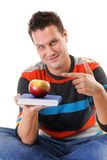 Man holding a book and one red apple Stock Image