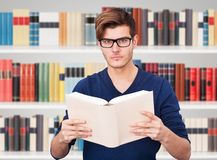 Man holding book Stock Photo