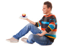 Man holding book red apple. Healthy body. Royalty Free Stock Photography