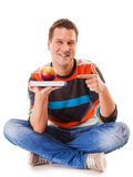 Man holding book and red apple. Healthy mind and body Stock Photography
