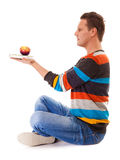 Man holding book and red apple. Healthy mind and body Stock Image