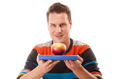 Man holding book and red apple. Healthy mind and body Royalty Free Stock Photography