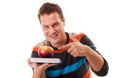 Man holding book and red apple. Healthy mind and body Stock Images