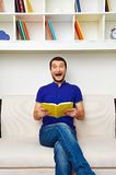 Man holding the book and screaming Royalty Free Stock Photos