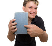 Man holding a book. On a white background Royalty Free Stock Photo