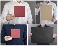A man holding booklet. A man holding a red and blue booklet royalty free stock photos