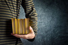 Man holding books Stock Photo