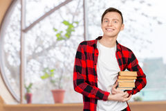 man holding books Stock Image