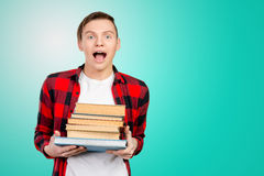 Man holding books Stock Images