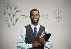 Man holding books has ideas ready for financial success stock photography