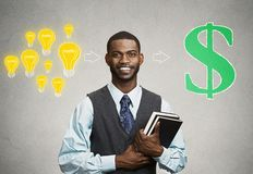 Man holding books has ideas ready for financial success Stock Photos