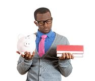 Man holding books and piggy bank Stock Image