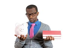 Man holding books and piggy bank Stock Images