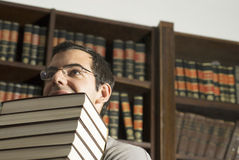 Man Holding Books - Vertical Royalty Free Stock Photo