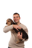 Man Holding a Borkie Dog Stock Images