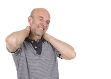 Man holding both hands behind neck Royalty Free Stock Photography