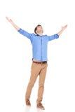 Man holding both hands up celebrating. Royalty Free Stock Photos