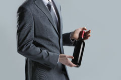 Man holding a bottle Stock Photo