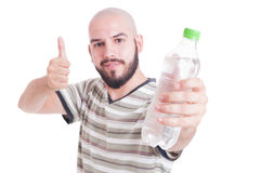 Man holding bottle of cold water and showing like gesture Royalty Free Stock Images