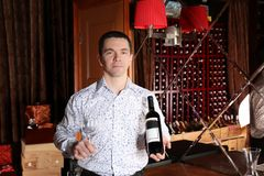 Man holding bottle of wine. Man holding bottle of red wine royalty free stock photos