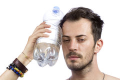 Man holding a bottle of water Stock Image