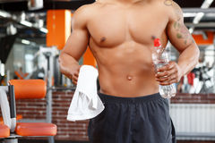 Man holding bottle of water in gym Stock Photo