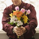 Man holding bouquet. Stock Image