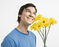 Man holding bouquet. Royalty Free Stock Photo