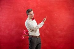 Man holding bouquet of carnations behind back Royalty Free Stock Photo