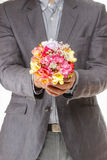Man holding bouquet of colorful freesia flowers Royalty Free Stock Photos