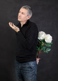 Man holding a bouquet of flowers Royalty Free Stock Photo