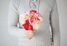 Man holding bouquet of flowers Stock Image