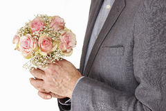 Man holding bouquet of pink roses Stock Photography