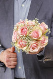 Man holding bouquet of pink roses Stock Photo