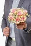 Man holding bouquet of pink roses Royalty Free Stock Photography
