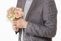 Man holding bouquet of pink roses Royalty Free Stock Images
