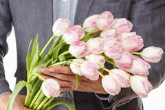 Man holding bouquet of pink tulips Stock Photos