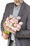 Man holding bouquet of pink tulips Royalty Free Stock Photo