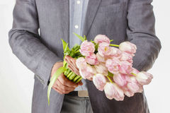 Man holding bouquet of pink tulips Stock Image