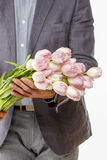 Man holding bouquet of pink tulips Royalty Free Stock Photos
