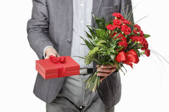 Man holding bouquet of red carnations Royalty Free Stock Photo