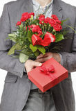 Man holding bouquet of red carnations Royalty Free Stock Photos