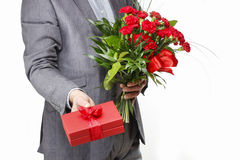 Man holding bouquet of red carnations Royalty Free Stock Photography