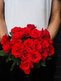 Man holding bouquet of red roses. A bouquet of red roses held by a man Royalty Free Stock Image