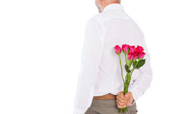 Man holding bouquet of roses behind back Stock Photo