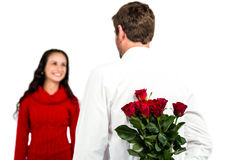 Man holding bouquet of roses with girlfriend. On white background Royalty Free Stock Photos